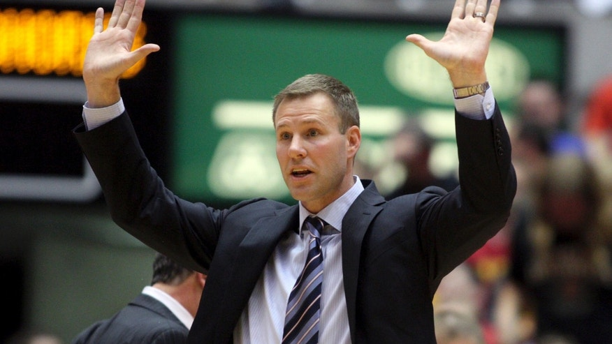 Iowa State coach Fred Hoiberg tells his players to go straight up with their hands on defense, after a foul during the second half of an NCAA college basketball game against Texas in Ames, Iowa, Tuesday, Feb. 18, 2014. Iowa State won 85-76. (AP Photo/Justin Hayworth)