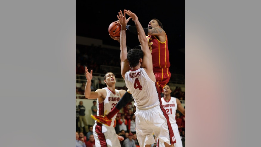 Southern California guard J.T. Terrell, top, shoots over Stanford's Stefan Nastic (4) during the first half of an NCAA college basketball game on Thursday, Feb. 20, 2014, in Stanford, Calif. (AP Photo/Marcio Jose Sanchez)