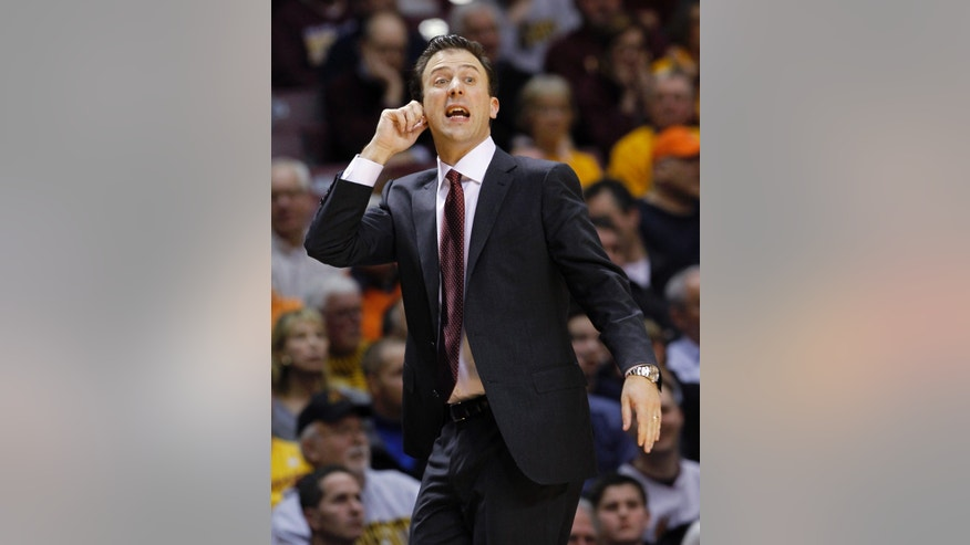 FILE - In this Feb. 19, 2014, file photo, Minnesota head coach Richard Pitino tugs on his ear as he calls out to his players during the second half of an NCAA college basketball game against Illinois in Minneapolis.  No. 24 Ohio State, still dogged by a bad spell in January, tries to stack together some solid wins as it heads into the Big Ten and NCAA tournaments. The next test comes Saturday against Minnesota, which beat the Buckeyes 63-53 when they went through that 1-5 downward spiral. (AP Photo/Ann Heisenfelt, File)