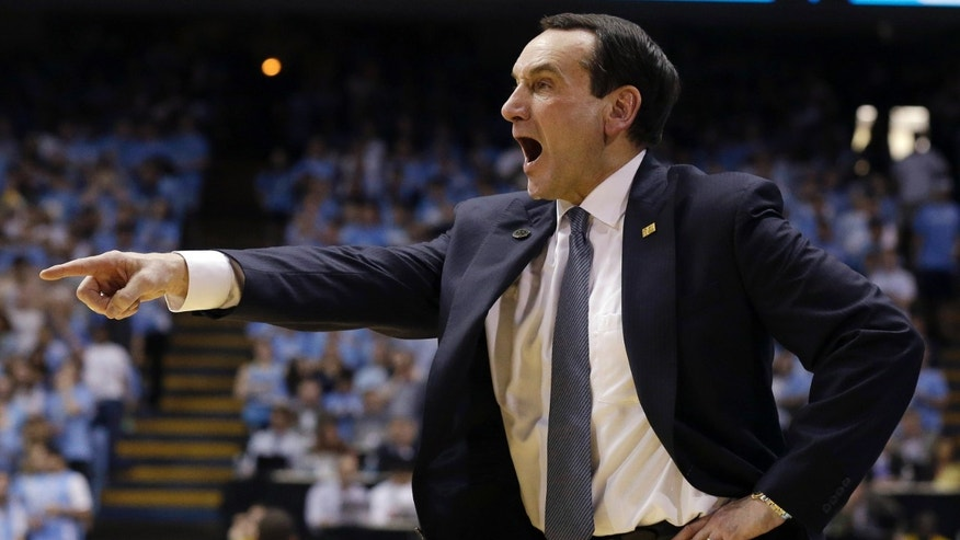 Duke coach Mike Krzyzewski points during the second half of an NCAA college basketball game against North Carolina in Chapel Hill, N.C., Thursday, Feb. 20, 2014. North Carolina won 74-66. (AP Photo/Gerry Broome)