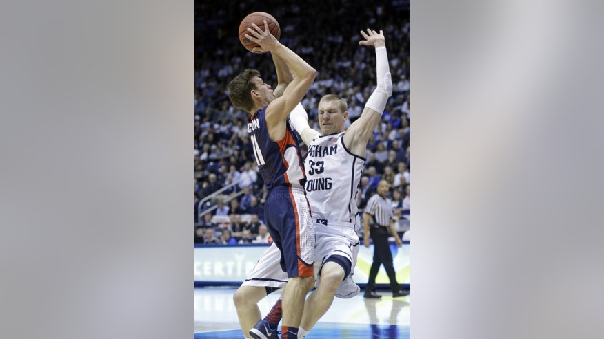 Brigham Young's Nate Austin (33) defends against Gonzaga's David Stockton (11) in the first half of an NCAA college basketball game, Thursday, Feb. 20, 2014, in Provo, Utah. (AP Photo/Rick Bowmer)