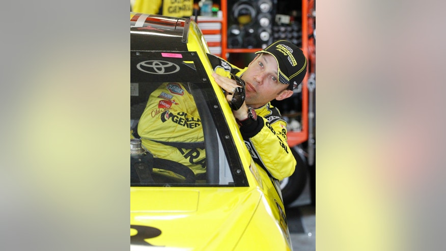 Matt Kenseth climbs in his car before the start of a practice session for the Daytona 500 NASCAR Sprint Cup Series auto race at Daytona International Speedway in Daytona Beach, Fla., Friday, Feb. 21, 2014. (AP Photo/Terry Renna)