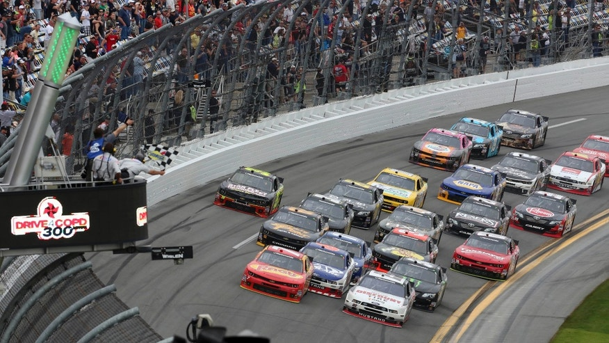 Regan Smith, front left, races the field to the checkered flag to win the NASCAR Nationwide Series auto race at Daytona International Speedway in Daytona Beach, Fla., Saturday, Feb. 22, 2014. (AP Photo/David Graham)