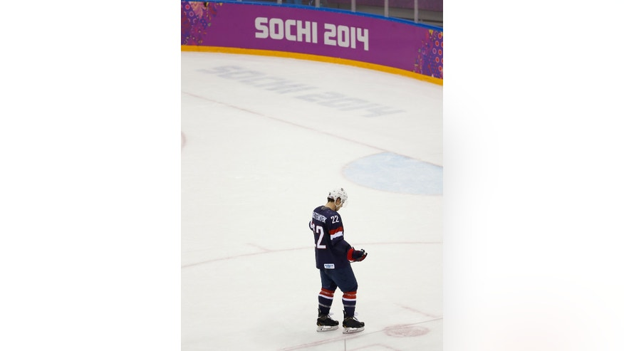 Kevin Shattenkirk of the United States (22) skates off the ice after the team's 5-0 loss to Finland in the men's bronze medal ice hockey game at the 2014 Winter Olympics, Saturday, Feb. 22, 2014, in Sochi, Russia. (AP Photo/Matt Slocum)