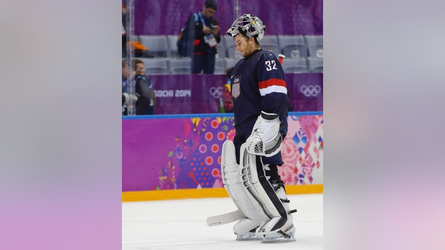 USA goaltender Jonathan Quick skates off the ice after Finland beat the USA 5-0 in the men's bronze medal ice hockey game at the 2014 Winter Olympics, Saturday, Feb. 22, 2014, in Sochi, Russia. (AP Photo/Petr David Josek)