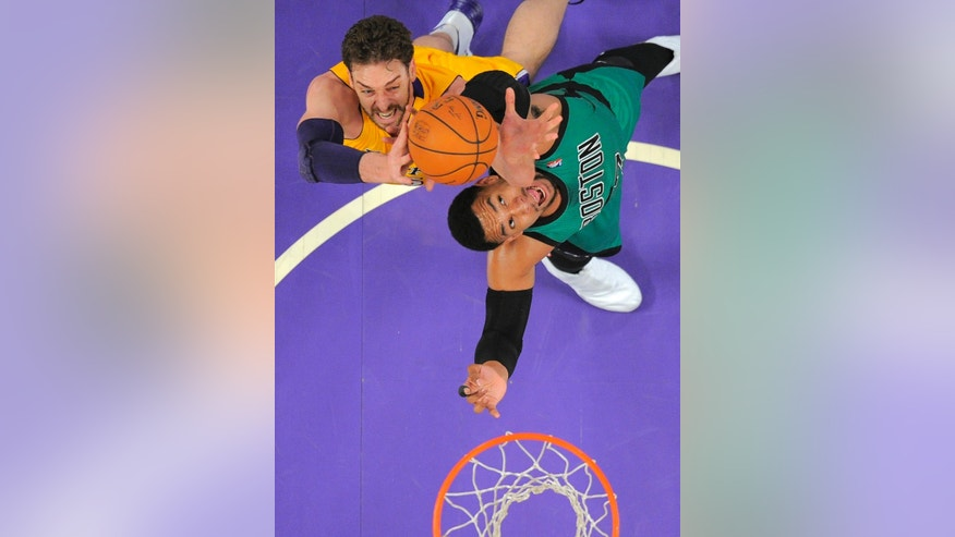 Los Angeles Lakers center Pau Gasol, left, of Spain, and Boston Celtics center Jared Sullinger battle for a rebound during the first half of an NBA basketball game, Friday, Feb. 21, 2014, in Los Angeles. (AP Photo/Mark J. Terrill)