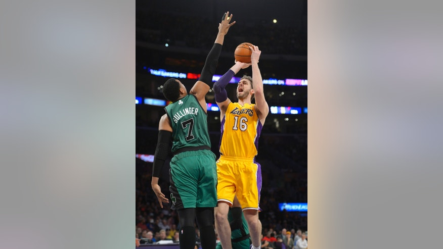 Los Angeles Lakers center Pau Gasol, right, puts up a shot as Boston Celtics center Jared Sullinger defends during the first half of an NBA basketball game, Friday, Feb. 21, 2014, in Los Angeles. (AP Photo/Mark J. Terrill)