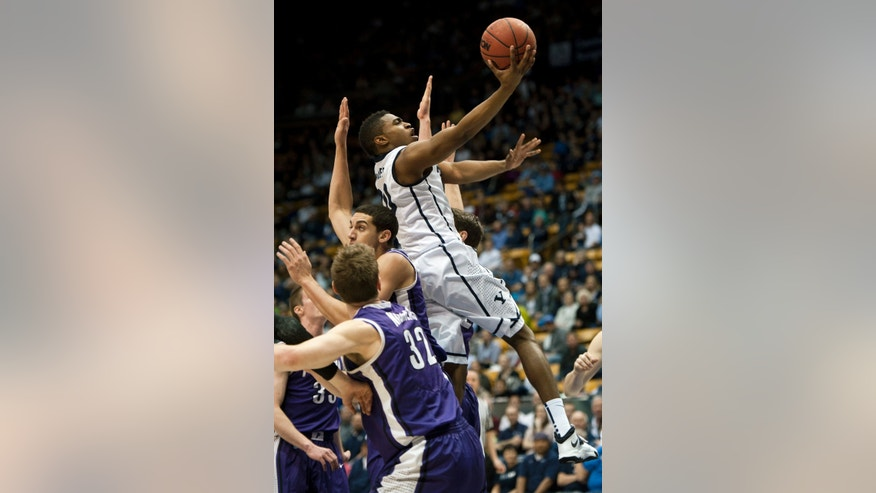 BYU's Anson Winder goes to the basket over Portland's defense during the first half of an NCAA college basketball game in Provo, Utah, Saturday, Feb. 22, 2014. (AP Photo/The Daily Herald, Grant Hindsley)