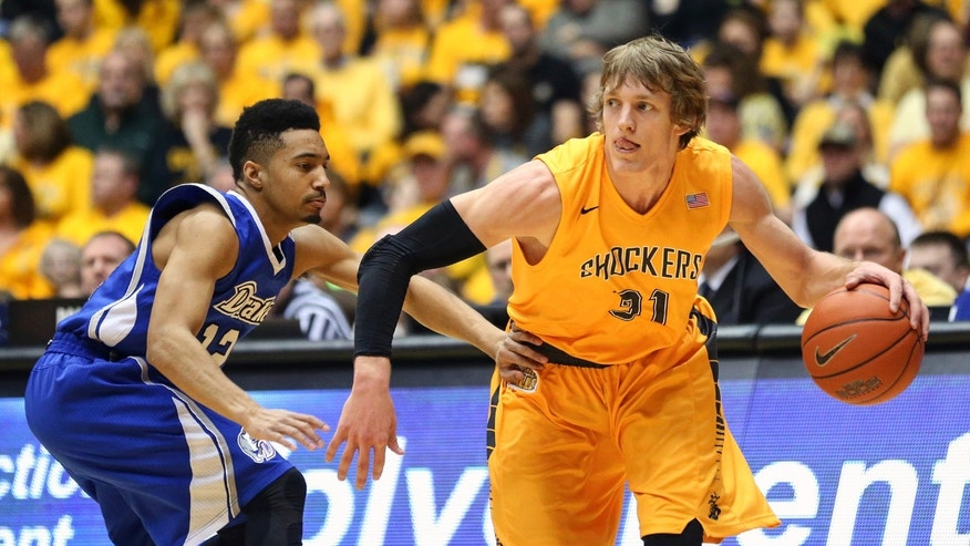 Wichita State's Ron Baker (31) dribbles around Drake'a Jordan Daniels (12) during an NCAA basketball game, Saturday, Feb. 22, 2014 in Wichita, Kan. (AP Photo/The Wichita Eagle, Fernando Salazar) LOCAL TV OUT; MAGS OUT; LOCAL RADIO OUT; LOCAL INTERNET OUT
