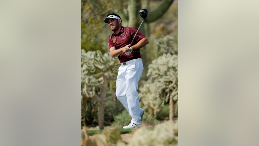 Louis Oosthuizen, of South Africa, watches his tee shot on the 17th hole during the fourth round of the Match Play Championship golf tournament on Saturday, Feb. 22, 2014, in Marana, Ariz. (AP Photo/Matt York)