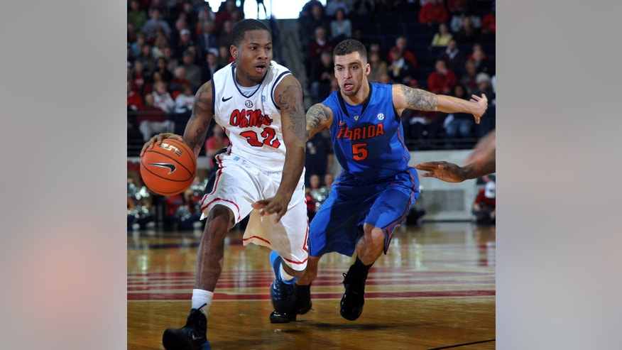 Mississippi's Jarvis Summers (32) dibbles against Florida's Scottie Wilbekin (5) during an NCAA college basketball game in Oxford, Miss., Saturday, Feb. 22, 2014. (AP Photo/Oxford Eagle, Bruce Newman)