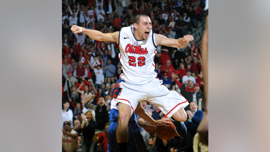 Mississippi's Marshall Henderson (22) celebrates after dunking against Florida during an  NCAA college basketball game in Oxford, Miss., Saturday, Feb. 22, 2014. (AP Photo/Oxford Eagle, Bruce Newman)  MANDATORY CREDIT