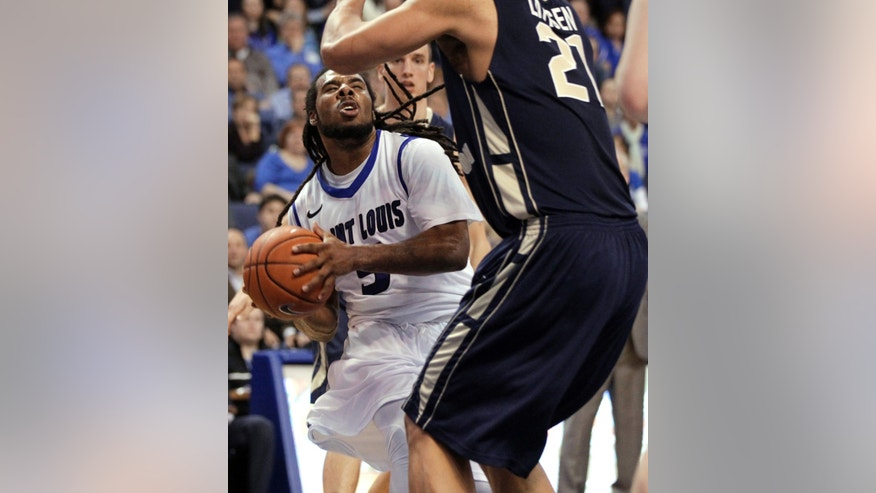 Saint Louis' Jordair Jett, left, heads to the basket as George Washington's Kevin Larsen defends during the second half of an NCAA college basketball game Saturday, Feb. 22, 2014, in St. Louis. Jett scored 16 points to lead Saint Louis to a 66-59 victory.(AP Photo/Whitney Curtis)