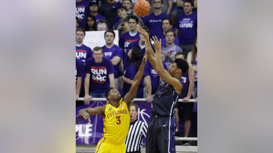 TCU center Karviar Shepherd (1) shoots against Iowa State forward Melvin Ejim (3) during the first half of an NCAA college basketball game Saturday, Feb. 22, 2014, in Fort Worth, Texas. (AP Photo/LM Otero)