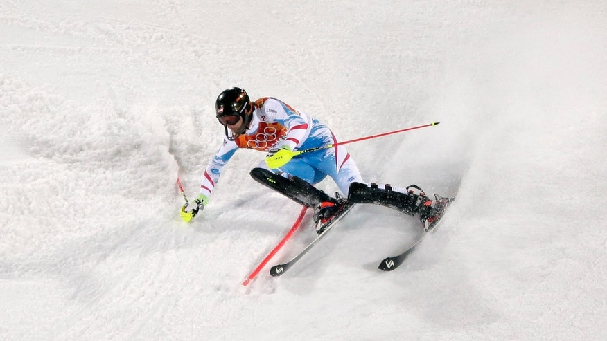Feb. 22, 2014: Austria's Mario Matt  skis past a gate in the second run of the men's slalom to win the gold medal at the Sochi 2014 Winter Olympics,  in Krasnaya Polyana, Russia.