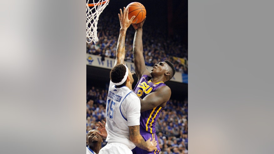 LSU's Johnny O'Bryant III shoots as Kentucky's Willie Cauley-Stein (15) defends during the first half of an NCAA college basketball game, Saturday, Feb. 22, 2014, in Lexington, Ky. (AP Photo/James Crisp)