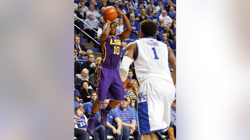 LSU's Andre Stringer (10) shoots as Kentucky's James Young (1) defends during the first half of an NCAA college basketball game, Saturday, Feb. 22, 2014, in Lexington, Ky. (AP Photo/James Crisp)