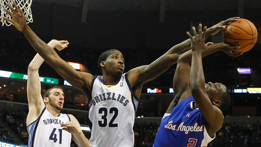 Memphis Grizzlies forward Ed Davis (32) blocks Los Angeles Clippers guard Darren Collison's (2) shot as center Kosta Koufos (41) looks on in the first half of an NBA basketball game Friday, Feb. 21, 2014, in Memphis, Tenn. (AP Photo/Lance Murphey)