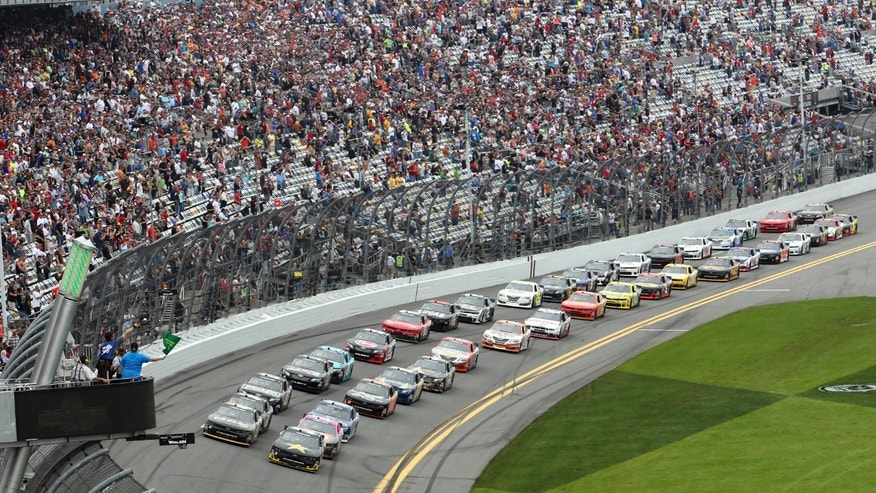 The field takes the green flag to start the NASCAR Nationwide series auto race at Daytona International Speedway in Daytona Beach, Fla., Saturday, Feb. 22, 2014. (AP Photo/David Graham)