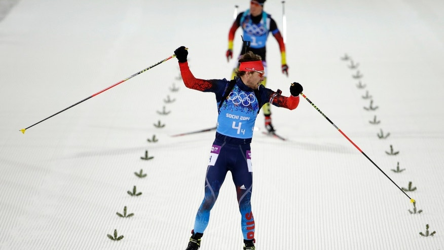 Feb. 22, 2014: Russia's Anton Shipulin celebrates as he looks back at silver medalist Germany's Simon Schempp, on his way to win the gold in the men's biathlon 4x7.5K relay at the 2014 Winter Olympics, in Krasnaya Polyana, Russia.