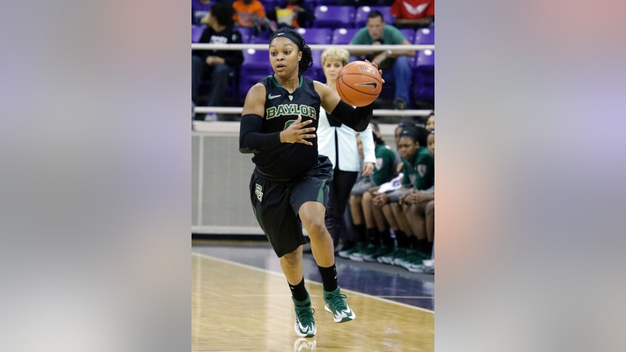 Baylor guard Odyssey Sims (0) dribbles the ball up court during the first half of an NCAA college basketball game against the TCU Saturday, Feb. 22, 2014, in Fort Worth, Texas. (AP Photo/LM Otero)