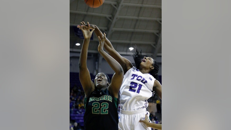 Baylor center Sune Agbuke (22) and TCU center Latricia Lovings (21) jumps for the rebound during the first half of an NCAA college basketball game Saturday, Feb. 22, 2014, in Fort Worth, Texas. (AP Photo/LM Otero)