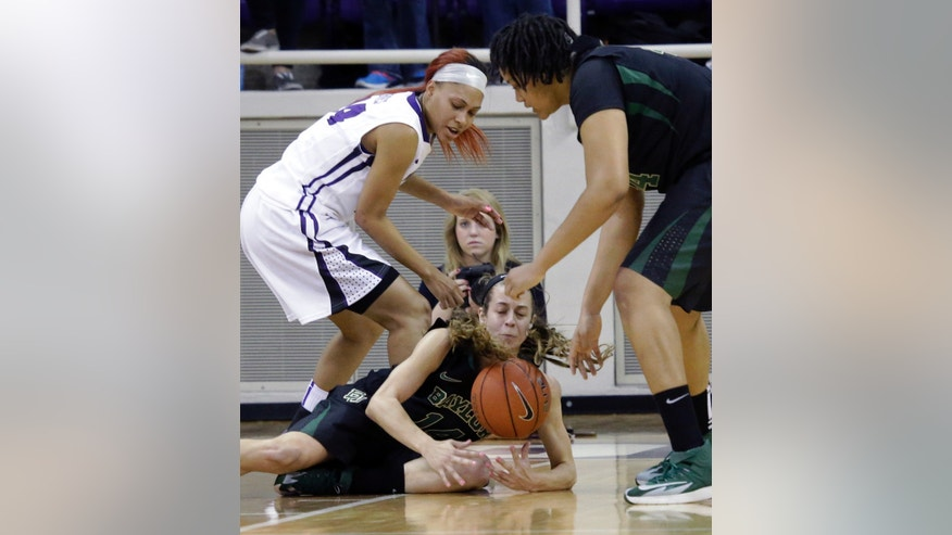 Baylor center Mariah Chandler (11)  grabs the loose ball against TCU guard Natalie Ventress (24) during the first half of an NCAA college basketball game Saturday, Feb. 22, 2014, in Fort Worth, Texas.  Looking on is Baylor center Kristina Higgins (44), (AP Photo/LM Otero)
