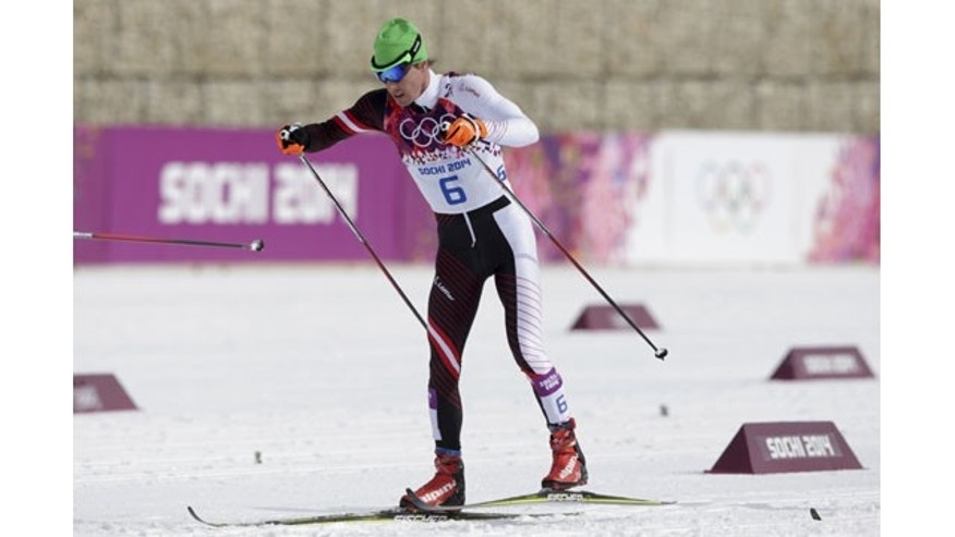 February 9, 2014: Austria's Johannes Duerr competes during the men's cross-country 30k skiathlon at the 2014 Winter Olympics in Krasnaya Polyana, Russia. Duerr has been kicked out of the Sochi Games after testing positive for EPO. It is the fifth doping case of the Olympics and the first involving the blood-boosting drug EPO. (AP Photo/Matthias Schrader)