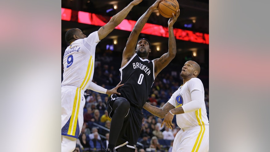Brooklyn Nets' Andray Blatche, center, shoots between Golden State Warriors' Andre Iguodala, left, and Marreese Speights during the first half of an NBA basketball game Saturday, Feb. 22, 2014, in Oakland, Calif. (AP Photo/Ben Margot)