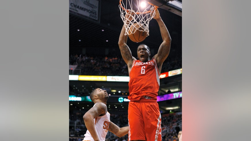 Houston Rockets power forward Terrence Jones (6), right, dunks on Phoenix Suns power forward Marcus Morris (15) in the first quarter during an NBA basketball game, Sunday, Feb. 23, 2014, in Phoenix. (AP Photo/Rick Scuteri)