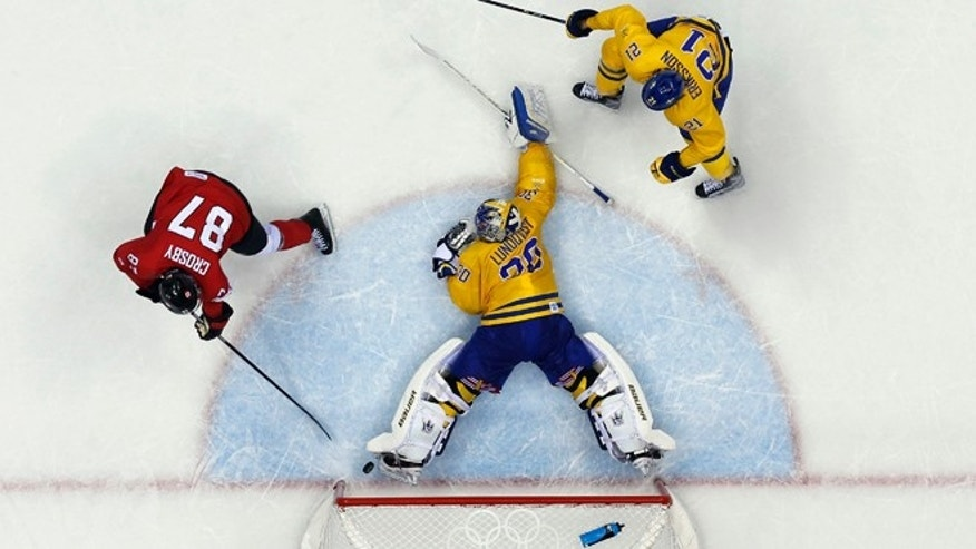 Feb. 23, 2014: Canada forward Sidney Crosby scores a goal on Sweden goaltender Henrik Lundqvist during the second period of the men's gold medal ice hockey game at the 2014 Winter Olympics in Sochi, Russia.