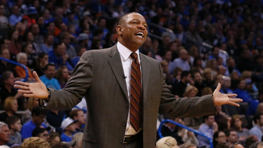 Los Angeles Clippers head coach Doc Rivers gestures to an official in the first quarter of an NBA basketball game against the Oklahoma City Thunder in Oklahoma City, Sunday, Feb. 23, 2014. (AP Photo/Sue Ogrocki)