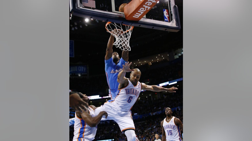 Los Angeles Clippers center DeAndre Jordan (6) misses a dunk after a foul by Oklahoma City Thunder guard Derek Fisher (6) in the second quarter of an NBA basketball game, Sunday, Feb. 23, 2014, in Oklahoma City. (AP Photo/Sue Ogrocki)