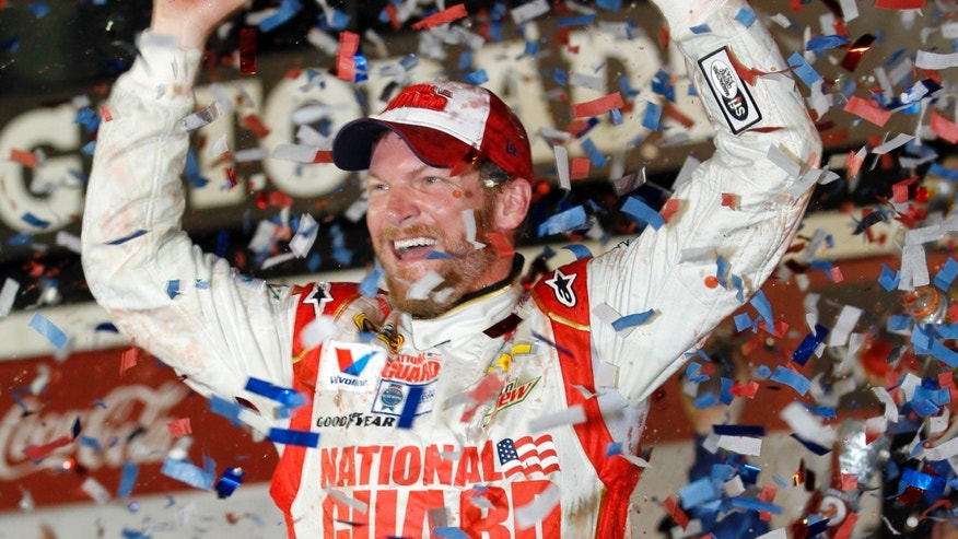 Dale Earnhardt Jr. celebrates in Victory Lane after winning the NASCAR Daytona 500 Sprint Cup series auto race at Daytona International Speedway in Daytona Beach, Fla., Sunday, Feb. 23, 2014. (AP Photo/Terry Renna)