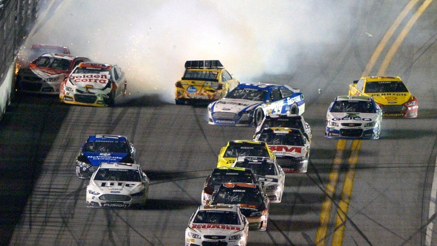 Dale Earnhardt Jr. (88) escapes a final lap wreck and leads to win the NASCAR Daytona 500 auto race at Daytona International Speedway in Daytona Beach, Fla., Sunday, Feb. 23, 2014. (AP Photo/Phelan M. Ebenhack)