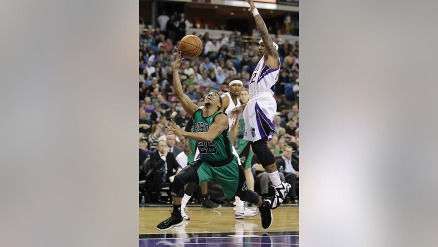 Boston Celtics guard Phil Pressey, left drives to the basket against Sacramento Kings guard Isaiah Thomas during the first quarter of an NBA basketball game in Sacramento, Calif., Saturday, Feb. 22, 2014. (AP Photo/Rich Pedroncelli)