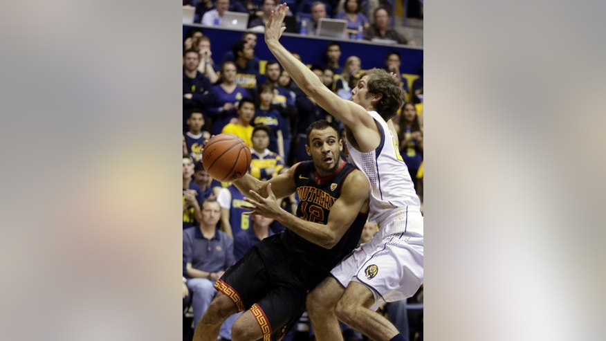 Southern California's Julian Jacobs (12) drives the ball around California's Ricky Kreklow in the first half of an NCAA college basketball game, Sunday, Feb. 23, 2014, in Berkeley, Calif. (AP Photo/Ben Margot)