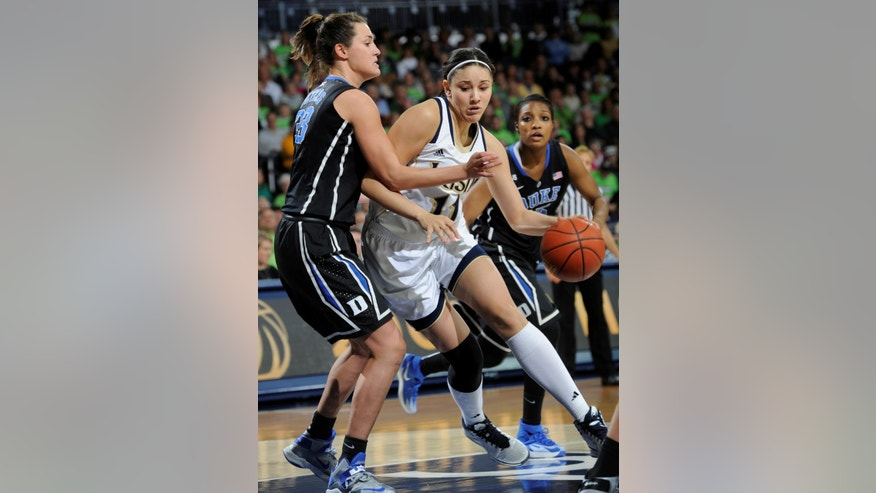 Notre Dame forward Natalie Achonwa, right, drives the lane as Duke forward Haley Peters defends during first half action in an NCAA college basketball game Sunday, Feb. 23, 2014 in South Bend, Ind. (AP Photo/Joe Raymond)