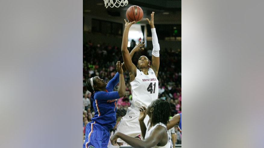 South Carolina's Alaina Coates (41) drives for the basket as Florida's Jaterra Bonds (10) tries to block during the first half of their NCAA women's college basketball game, Sunday, Feb. 23, 2014, in Columbia, S.C. (AP Photo/Mary Ann Chastain)
