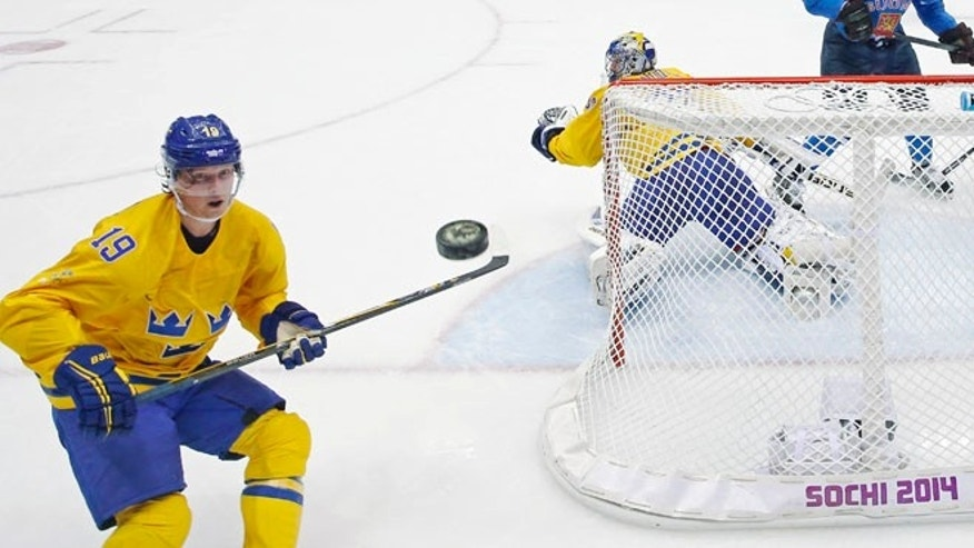 Feb. 21, 2014: Sweden forward Nicklas Backstrom watches a shot that got past Sweden goaltender Henrik Lundqvist during a men's semifinal ice hockey game against Finland at the 2014 Winter Olympics in Sochi, Russia.