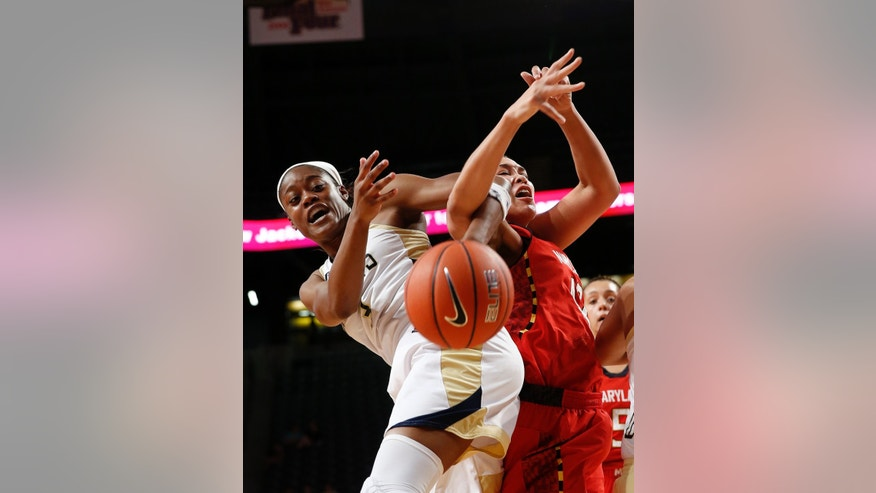 Georgia Tech guard Kaela Davis (3) and Maryland center Brionna Jones (42) fight for a rebound in the first half of an NCAA women's college basketball game, Sunday, Feb. 23, 2014, in Atlanta. (AP Photo/John Bazemore)
