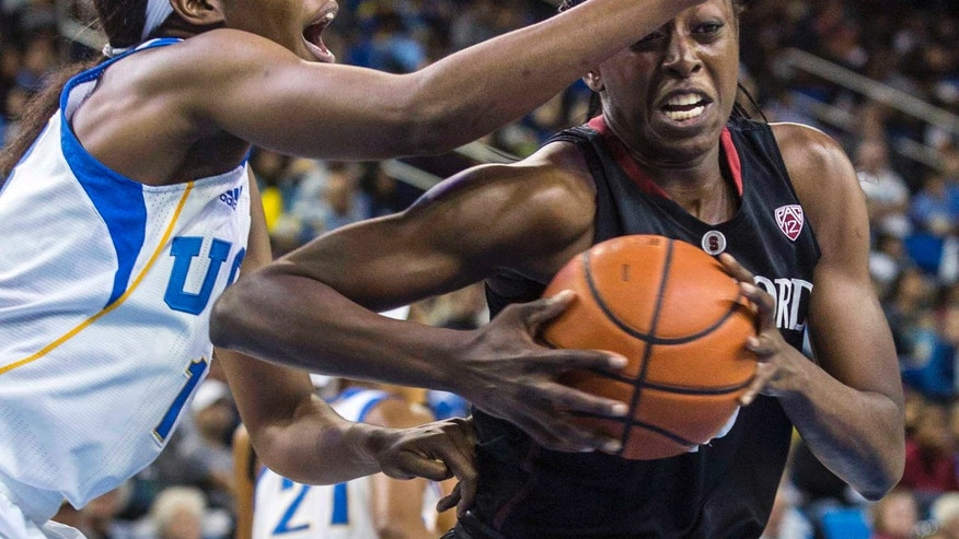 Stanford forward Chiney Ogwumike, right, drives past UCLA center Luiana Livulo, left, in the first half of an NCAA college basketball game, Sunday, Feb. 23, 2014 in Los Angeles. (AP Photo/Ringo H.W. Chiu)