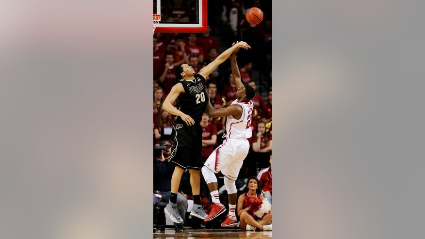 Purdue center A. J. Hammons (20) blocks the shot of Nebraska forward Leslee Smith (21) during the first half of an NCAA college basketball game in Lincoln, Neb., on Sunday, Feb. 23, 2014. (AP Photo/Francis Gardler)