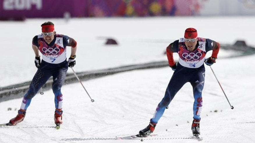 February 23, 2014: Russia's Alexander Legkov, right, skis to win the gold during the men's 50K cross-country race at the 2014 Winter Olympics, in Krasnaya Polyana, Russia. (AP Photo/Matthias Schrader)