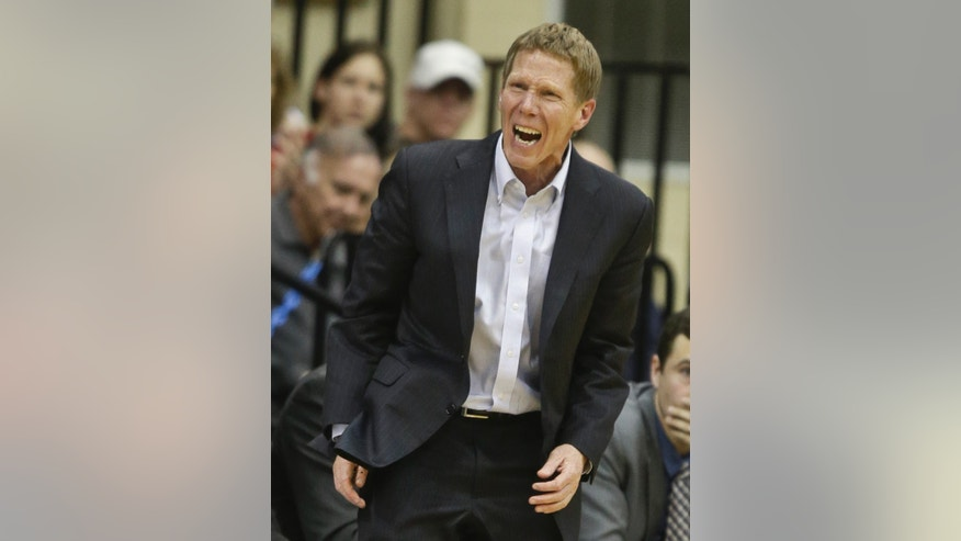 Gonzaga coach Mark Few isn't pleased with his teams' play during the first half of a NCAA college basketball game against San Diego Saturday, Feb. 22, 2014, in San Diego. (AP Photo/Lenny Ignelzi)