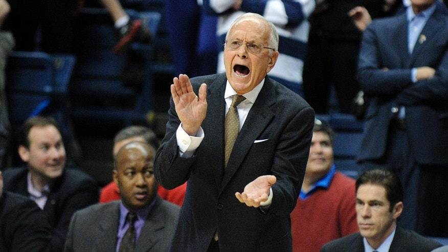 SMU head coach Larry Brown encourages his team during the first half of SMU's 64-55 victory over Connecticut in an NCAA college basketball game in Storrs, Conn., Sunday, Feb. 23, 2014. (AP Photo/Fred Beckham)
