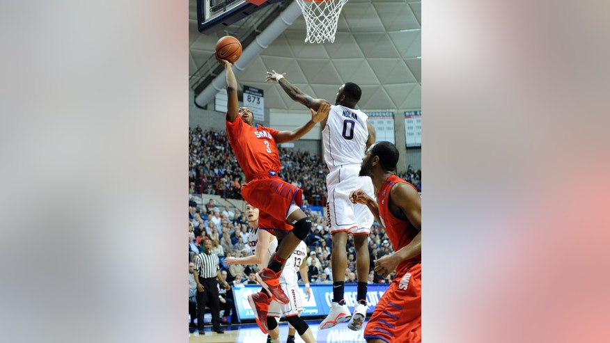 SMU's Sterling Brown (3) shoots over Connecticut's Phillip Nolan during the first half of an NCAA college basketball game in Storrs, Conn., Sunday, Feb. 23, 2014. (AP Photo/Fred Beckham)