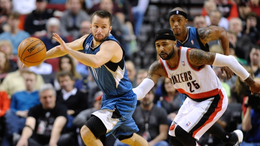 Minnesota Timberwolves' JJ Barea (11) runs against Portland Trail Blazers' Mo Williams (25) during the first half of an NBA basketball game in Portland, Ore., Sunday Feb. 23, 2014. (AP Photo/Greg Wahl-Stephens)