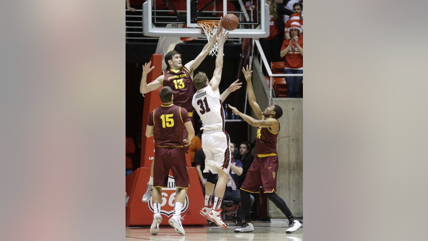 Utah's Dallin Bachynski (31) shoots as Arizona State's Jordan Bachynski (13) and teammates Egor Koulechov (15) and Jermaine Marshall, right, defend in the first half of an NCAA college basketball game, Sunday, Feb. 23, 2014, in Salt Lake City. (AP Photo/Rick Bowmer)