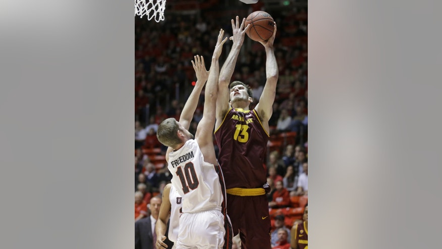 Arizona State's Jordan Bachynski (13) shoots as Utah's Renan Lenz (10) defends in the first half of an NCAA college basketball game, Sunday, Feb. 23, 2014, in Salt Lake City. (AP Photo/Rick Bowmer)